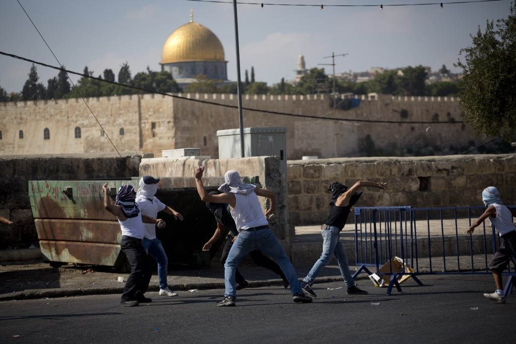 <p> 	Palestinian youth throw stones during clashes in the East Jerusalem neighborhood of Ras al Amud, September 27. Israeli police prevented Palestinian worshipers under the age of 50 to enter the Al-Aqsa Mosque.  Many prayed in different locations near police checkpoints. After the prayer, clashes began in some East Jerusalem neighborhoods.</p>